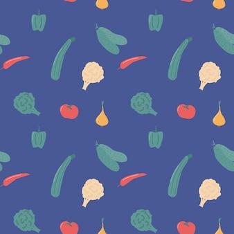 タマネギ、ピーマン、ズッキーニとのシームレスな野菜のパターン。青いベクトルの背景に分離されました。