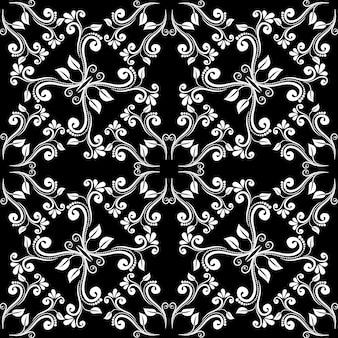 シームレスなヴィンテージバロックパターン。黒の背景に白い葉からの装飾