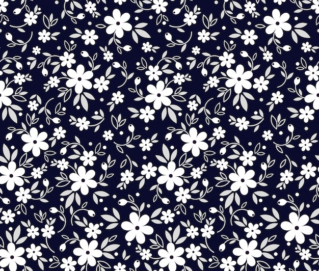 Seamless vintage floral pattern. dark blue background, small white flowers. black and white vector print with the ditsy motif. trendy desing for surface.