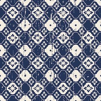 シームレスなヴィンテージ使い古した青い花の網目模様のパターン
