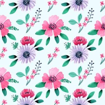 かわいいピンクの花と青い背景のシームレスな水彩パターン