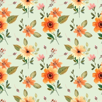 Seamless watercolor pattern with orange blooms and green leaves for spring