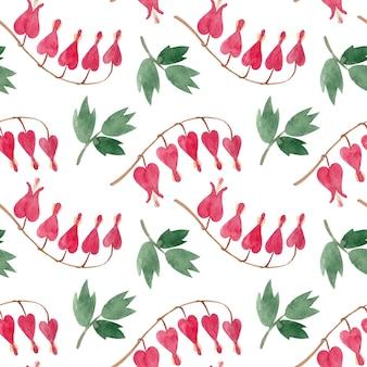 Бесшовный акварельный образец с розовыми цветами в форме сердца и зелеными листьями Premium векторы