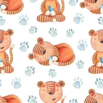 Seamless watercolor pattern with small striped tiger cubs blue birds and paw prints