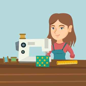 Seamstress using a sewing machine at the workshop.