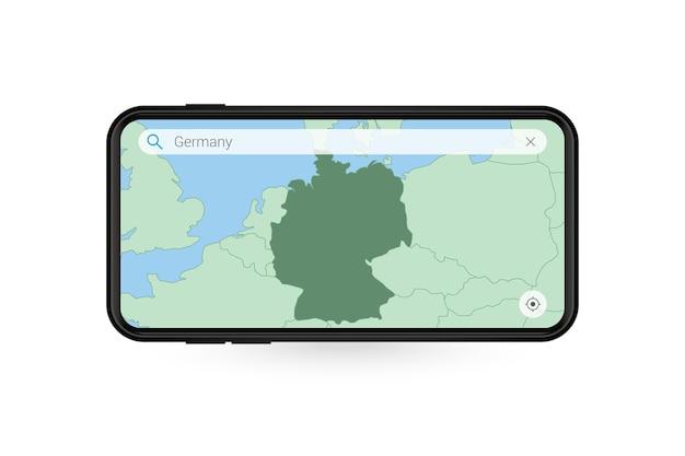 スマートフォンの地図アプリケーションでドイツの地図を検索しています。携帯電話でのドイツの地図。