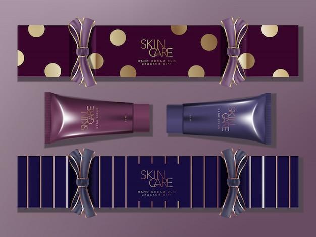 Seasonal gift cracker box packaging with grosgrain ribbon. blue & purple, stripe & spot pattern. metallic hand cream tube.