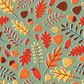 秋の落ち葉、枝、果実、緑色の背景でドングリと季節のシームレスなパターン。