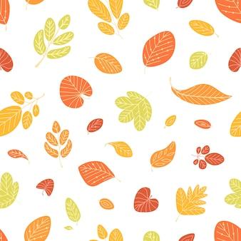 白い背景の上の秋の落ち葉と季節のシームレスパターン
