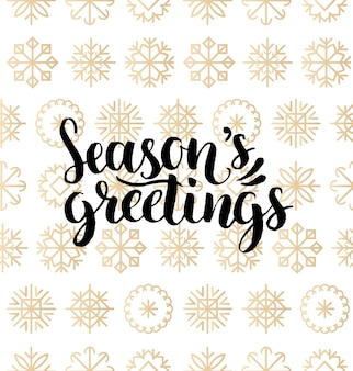 Seasons greetings lettering design on snowflakes background. christmas or new year seamless pattern for greeting card template. happy holidays poster concept.