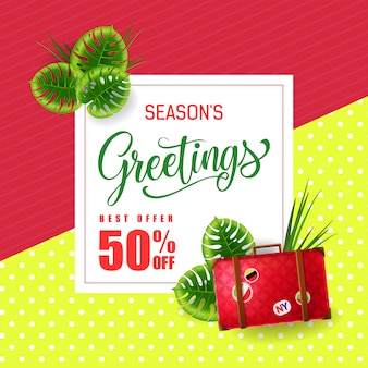 Seasons greetings lettering with luggage bag and tropical leaves.
