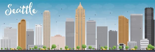 灰色の建物と青い空とシアトル市のスカイライン