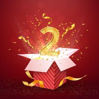 Годовщина второго года и открытая подарочная коробка с конфетти взрывов
