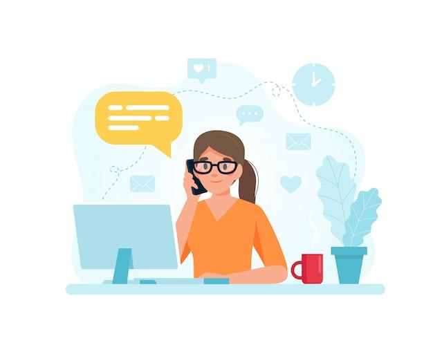 비서 여자는 전화에 응답하는 책상에 앉아.