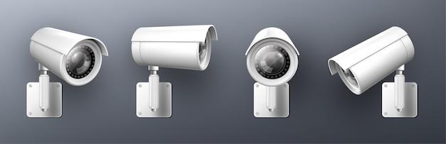 Камера безопасности, видеокамера видеонаблюдения, оборудование для наблюдения за улицами, фронтальный и боковой вид. надежный охранник и предупреждение преступности, изолированные на сером фоне, реалистичный набор 3d иллюстраций