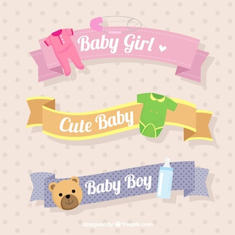 Selection of decorative ribbons with baby objects