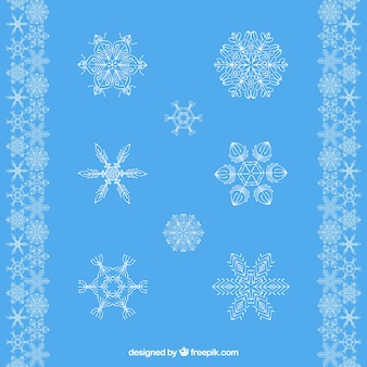 Selection of decorative snowflakes with blue background