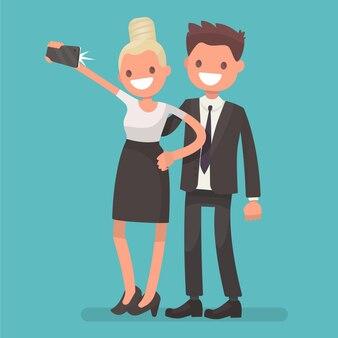 Selfieはオフィスワーカーを撃ちました。少女と男は写真を撮る