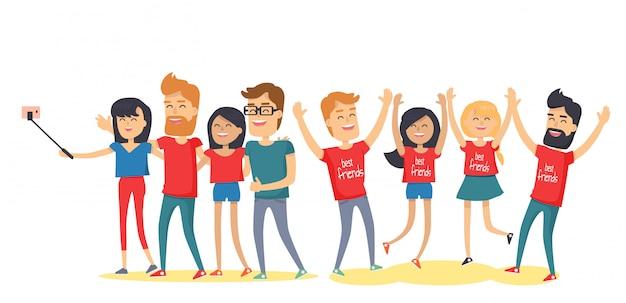 幸せな親友は一緒に楽しんでいます。若い男性と女性の上げられた手で笑って、selfieを作る