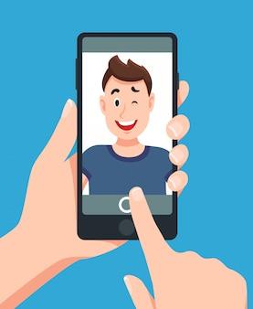 スマートフォンのselfieの肖像画を取る人