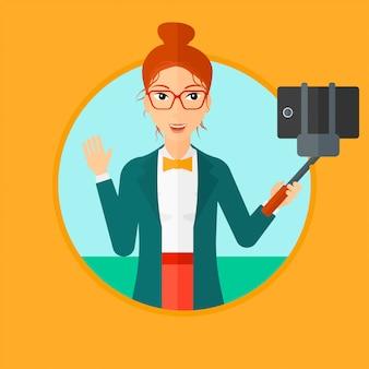 Selfieを作る女性。