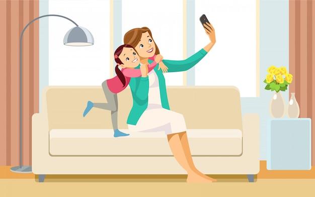 美しい学校の女の子と彼女のお母さん、selfieを取って