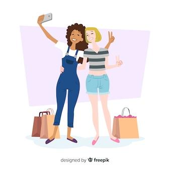 Selfieを取ってフラットなデザインの女性キャラクター