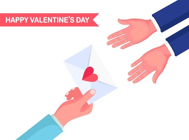 送信、ラブレターの受信、郵便によるメッセージ幸せなバレンタインデー赤いハートを手にした封筒