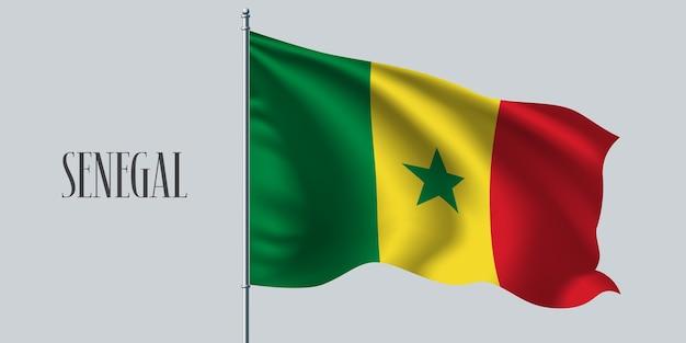 Senegal waving flag on flagpole.