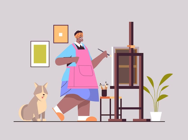 Старший афро-американский художник-женщина с собакой рисует картину творческой концепции хобби