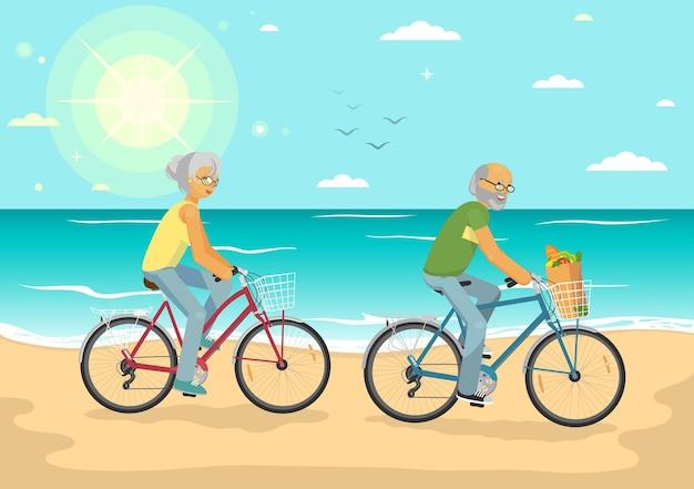 Senior couple on bikes senior woman and senior man cicling on the summer sea beach healthy lifestyle sport transportation concept