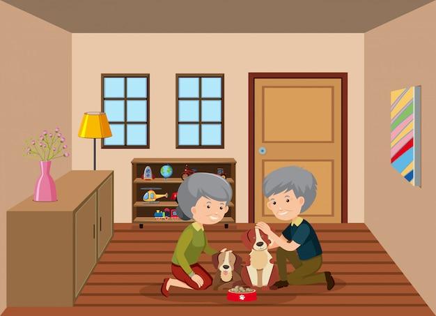 Senior couple feeding dogs