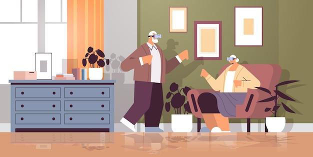 バーチャルリアリティインタラクティブサービスアクティブな老後を探るデジタルメガネでvrヘッドセットの祖父母を身に着けている年配のカップル