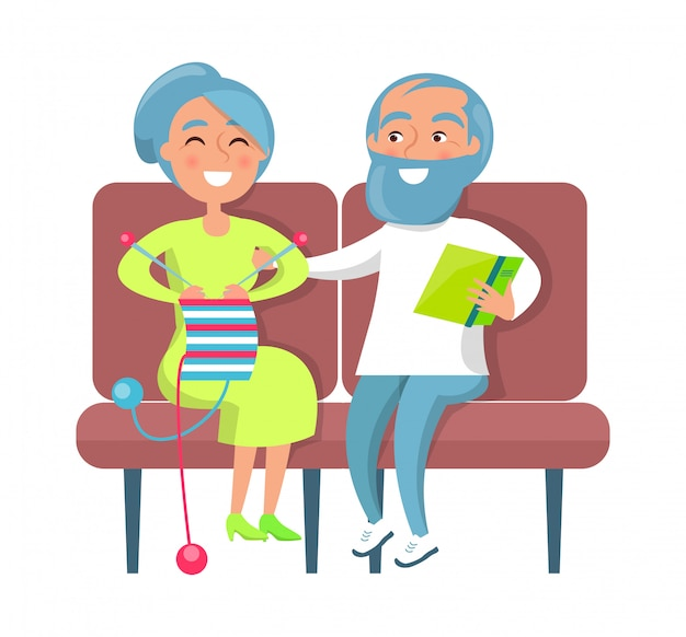 Senior lady knitting and gentleman reading on sofa