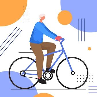 自転車トレーニング健康的なライフスタイルアクティブな老後の概念に乗って高齢のスポーツマンをサイクリングする年配の男性