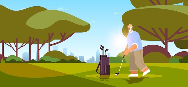 Senior man playing golf on green golf course aged player taking a shot active old age concept landscape background