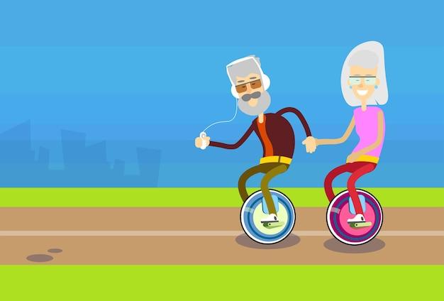 Senior man woman couple ride segway motor bicycle