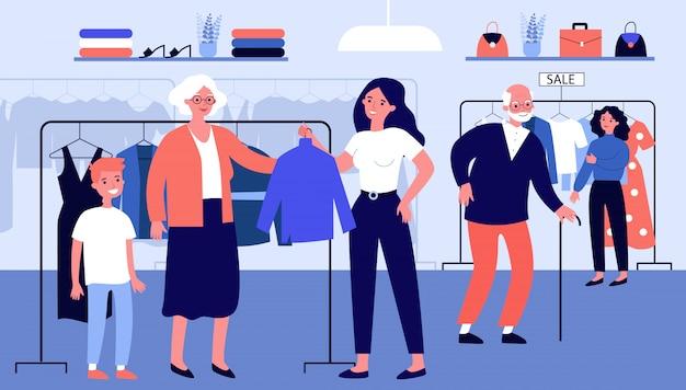 高齢者のファッション店で服を選ぶ