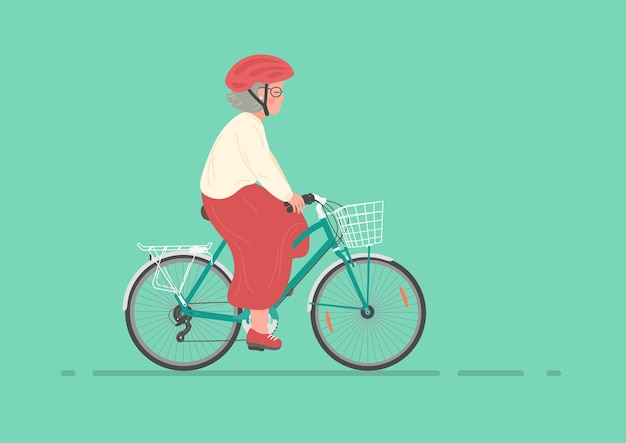Senior woman in helmet on bike elderly woman cycling