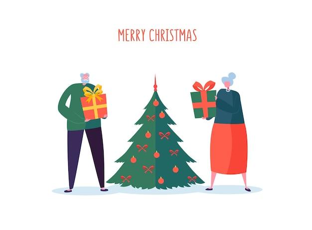 ギフトとクリスマスツリーを持つ高齢者