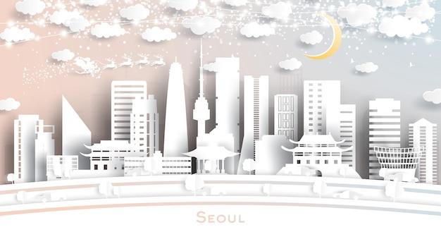눈송이, 달, 네온 화환이 있는 종이 컷 스타일의 서울 한국 도시 스카이라인. 벡터 일러스트 레이 션. 크리스마스와 새 해 개념입니다. 썰매에 산타 클로스입니다.
