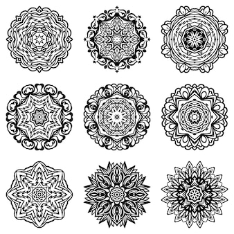 Set of abstract snowflake  silhouette and frame. black and white mandala ornamental decorative shapes.