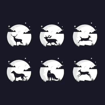 Set of animal silhouettes against the moon