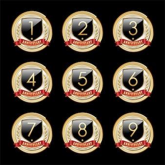 Set of anniversary emblems isolated on dark