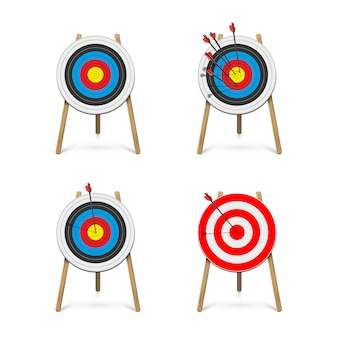 Set of archery target stands with arrows.