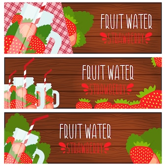 Set of banners with bright fruit water in mason jar with strawberries .