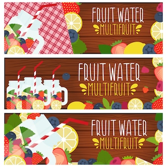 Set of banners with bright fruit water in mason jar with strawberries