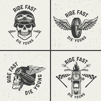 Set of biker emblems. racer skulls, winged wheels.  elements for logo, label, emblem, sign.  illustration