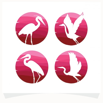 Set of bird silhouettes against gradient circle