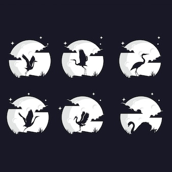 Set of bird silhouettes against the moon